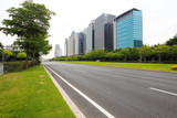 Empty road surface floor freeway with modern city buildings backgrounds