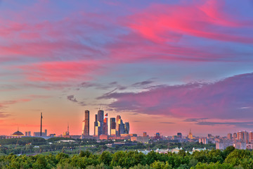 Bright clouds over Moscow City at sunset