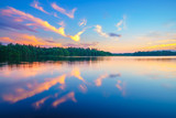 Beautiful landscape with colorful sunset over forest lake - 203334989