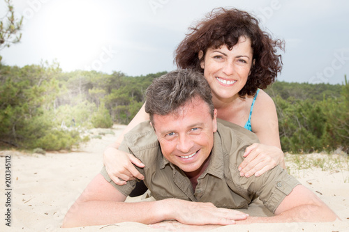 Attractive middle aged Couple on the Beach in summer