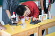 Little students study science in the classroom