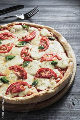 Fototapeta margarita pizza at wood