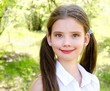 Portrait of adorable smiling little girl outdoors