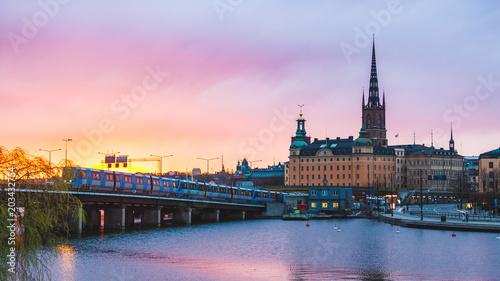 Plexiglas Stockholm Stockholm old town and metro at sunset