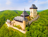 Aerial view to The Karlstejn castle. Royal palace founded King Charles IV. Amazing gothic monument in Czech Republic, Europe. - 203434712