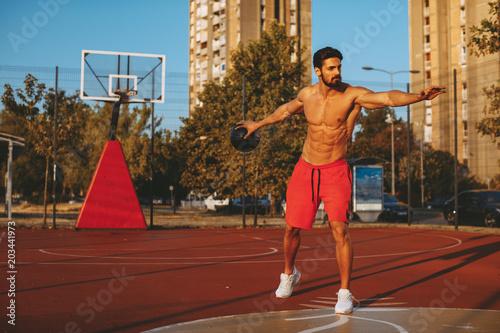 Plexiglas Basketbal Shirtless handsome man playing basketball