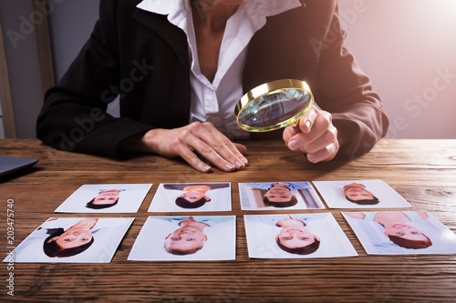 Businessperson Looking At Candidate's Photograph © Andrey Popov