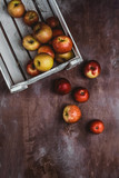 elevated view of apples in wooden box on rustic table