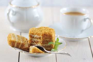 honey cake and a mint leaf on the saucer