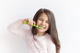Little cute child girl brushing her teeth on white background. Space for text. Healthy teeth. - 203496372