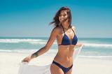Free woman carefree on beach