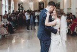 beautiful gorgeous bride and groom performing first dance. happy wedding couple dancing in restaurant at wedding reception. happy marriage moments. elopement concept - 203505918