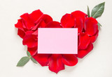 Envelope and red roses petals background flat lay text space, romantic card, love letter.