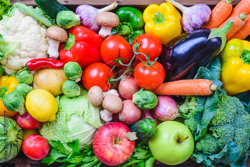 Vegetables and fruits top view background.