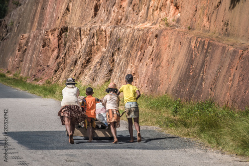 Creative variety of people and goods transport carts either human or zebu (oxen) powered alomng the legendary national route 7, south of Tana., Madagascar,
