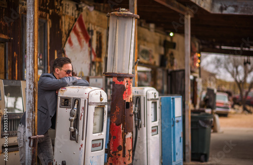 Canvas Route 66 Young man smokes a cigarette at a vintage gas pump