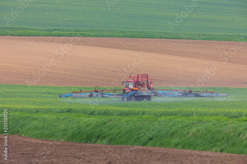 Plexiglas Zalm Spring chemical treatment of cereals with red tractor