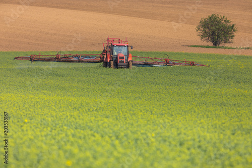 Plexiglas Pistache Spring chemical treatment of cereals with red tractor