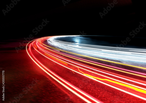 Fototapeta Curved car traffic light trails. 3D illustration