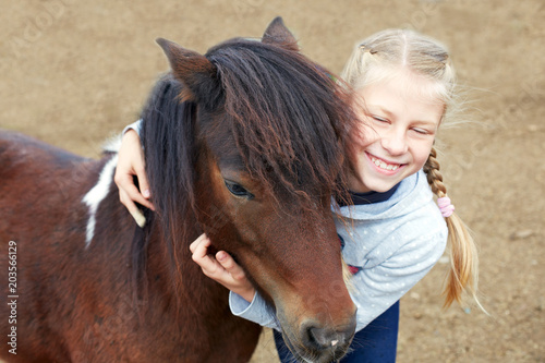 Fototapeta Pony and horsewoman - little girl and her best friend