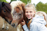 Pony and horsewoman - little girl and her best friend - 203566716