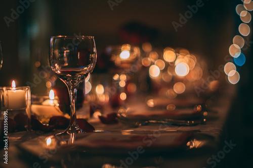Leinwanddruck Bild Romantic Wine Glass with Candles