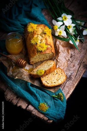 Foto Murales dandelion petal and honey  bread..selective focus