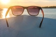Sunglasses on the beach, bright summer day