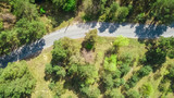 Aerial top view of park forest road with bike lanes from above, Truhaniv island, Kiev, Ukraine