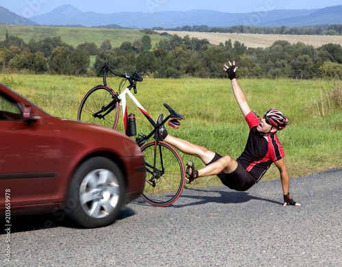 Accident cars with biker. Car collides cyclist on the road. Dangerous traffic on asphalt way on the countryside. Road crash misfortune car with a cyclist.  Careless driving.
