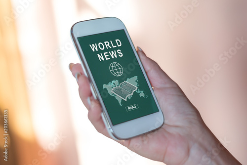 Foto Murales World news concept on a smartphone