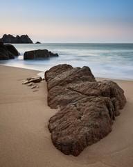 Stunning vibrant sunrise landscape image of Porthcurno beach on South Cornwall coast in England © veneratio