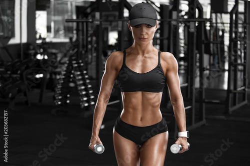 Sticker Sexy athletic girl working out in gym. Fitness woman doing exercise, sports concept