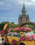 Beautiful floral decoration of an old car in Timisoara, Romania - 203700339
