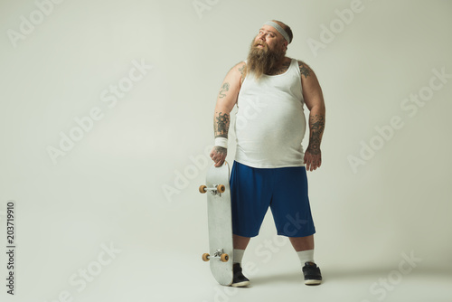Plexiglas Skateboard I will be a great skateboarder. Full length portrait of dreamful thick guy holding skate and smiling. Copy space
