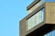 Urban abstract background, detail of modern glass facade, office business building.