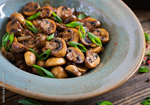 Baked mushrooms with soy sauce and herbs. Vegan food. © timolina