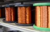 Row of copper wire coils in close up view - 203746523