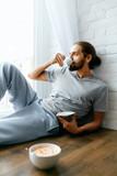 Morning Coffee. Man Enjoying Hot Drink Near Window - 203758545