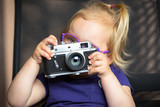Little girl making photo with vintage camera - 203761372