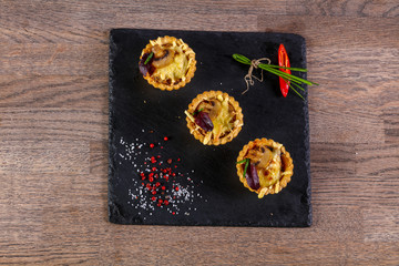 Canape with mushroom and cheese