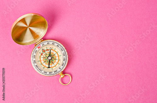 Vintage gold compass on pink paper - 203778319