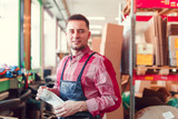 Image of man in apron with bag in hands at shop for making coffee - 203798115
