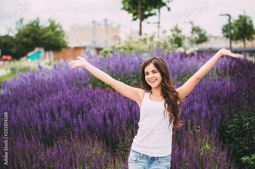 Fototapeta Joyful free girl outdoors.