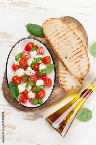Caprese bruschetta toasts cooking - 203820395