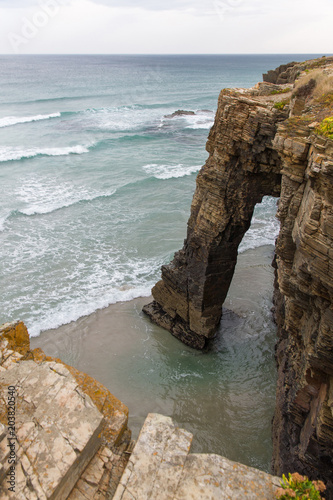 View from above of one of the rocky arches on the coast of Playa de las Catedrales in Lugo Spain