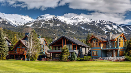 Luxury Homes on Nicklaus North Golf Course in Whistler on a sunny Spring day with Blackcomb Mountain in the background. Whistler, British Columbia Canada