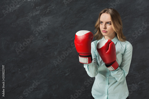 Woman in red boxing glove punch to the goal