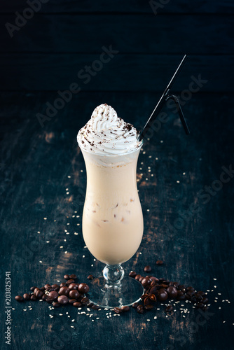 Canvas Milkshake Milk shake. On a black wooden background. Copy space.
