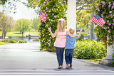 Young Sister and Brother Waving American Flags At The Park - 203828762